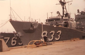 USS Barry (DD 933) Tied Up to the Pier in Newport, Rhode Island. Outboard ship is the USS William C. Lawe (DD-763) May 21, 1982