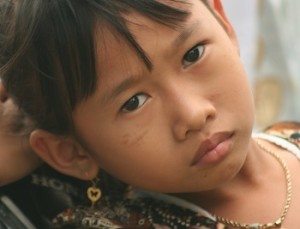 Young girl from a very primitive tribe.