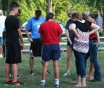 Youth from DeKalb County Indiana uniting in prayer for revival.